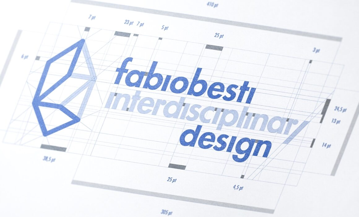 Close-up on the technical drawing of the new logo of Fabio Besti Interdisciplinary Design in the color version